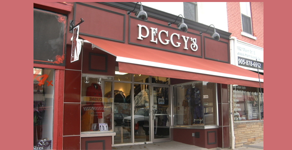 image of an awning - wine coloured covering Peggy's store